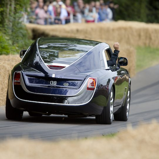 Rear view of a limited edition Rolls Royce Sweptail driving off during an event