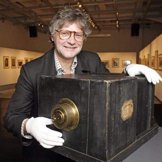 Man poses with rare and collectible camera