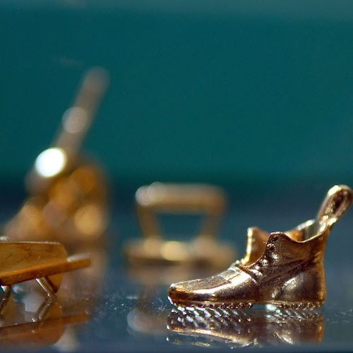 Gold Monopoly game pieces