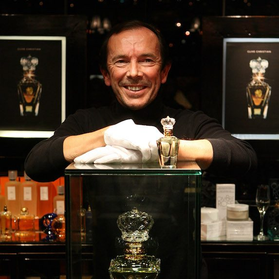 Clive Christian stands with his perfume on display at Harrods in London during a ceremony for the Guinness World Record