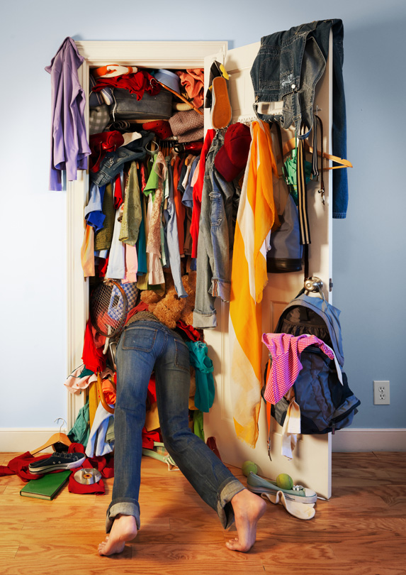 Closet jammed with clothes
