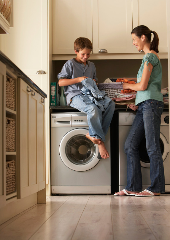 Mother and son in laundry room