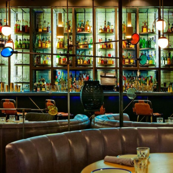 The colourful and leather-accented bar lounge or Byblos
