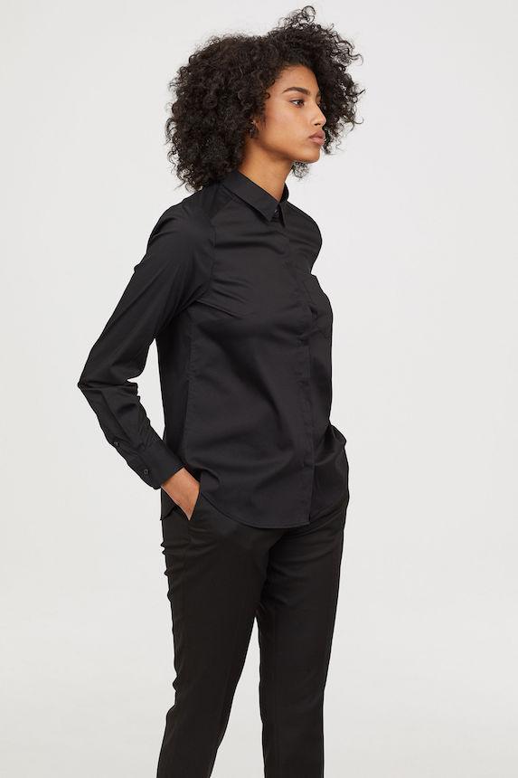 Model wears black button-down blouse