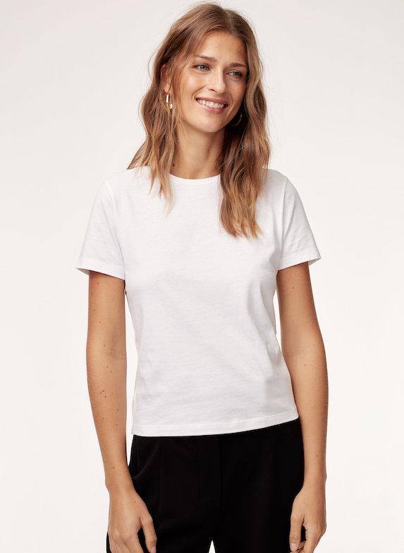Model wears white t-shirt