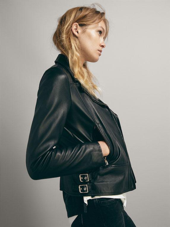 Model wears black leather jacket