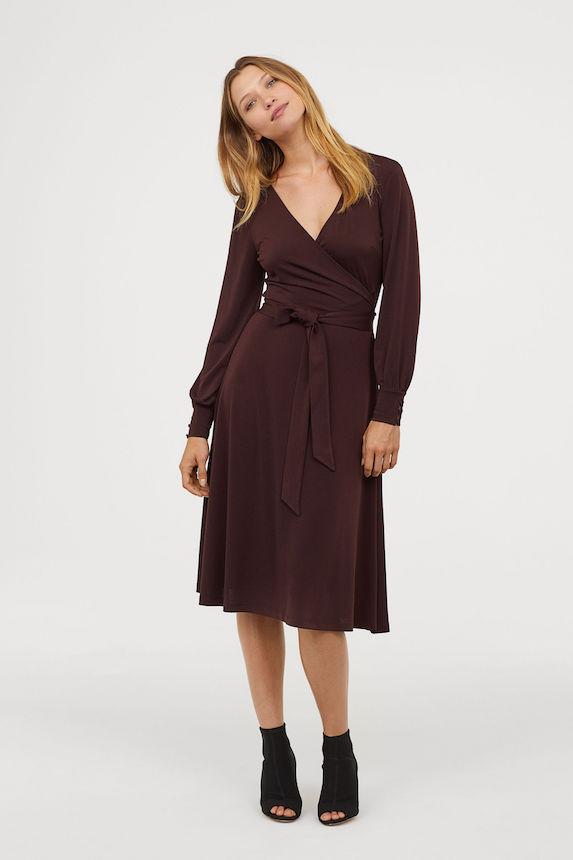 Model wears dark red jersey wrap dress