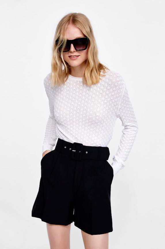 Model wears black shorts