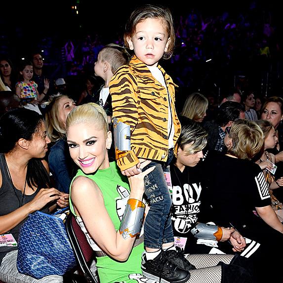 Apollo standing on mom Gwen Stefani's lap