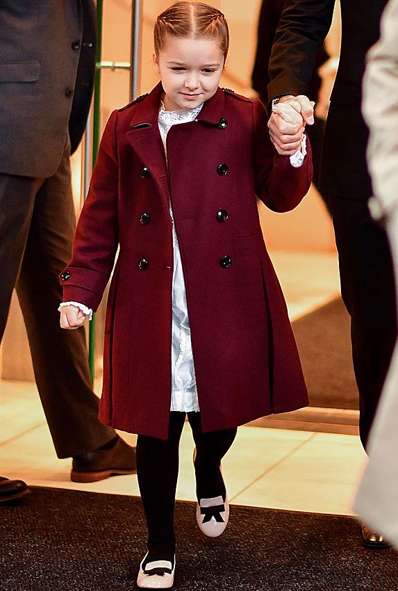 Harper Beckham walking out of building