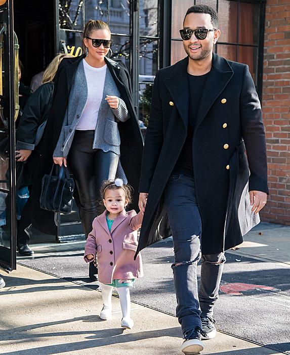 Chrissy Teigen, John Legend and daughter Luna walking in New York