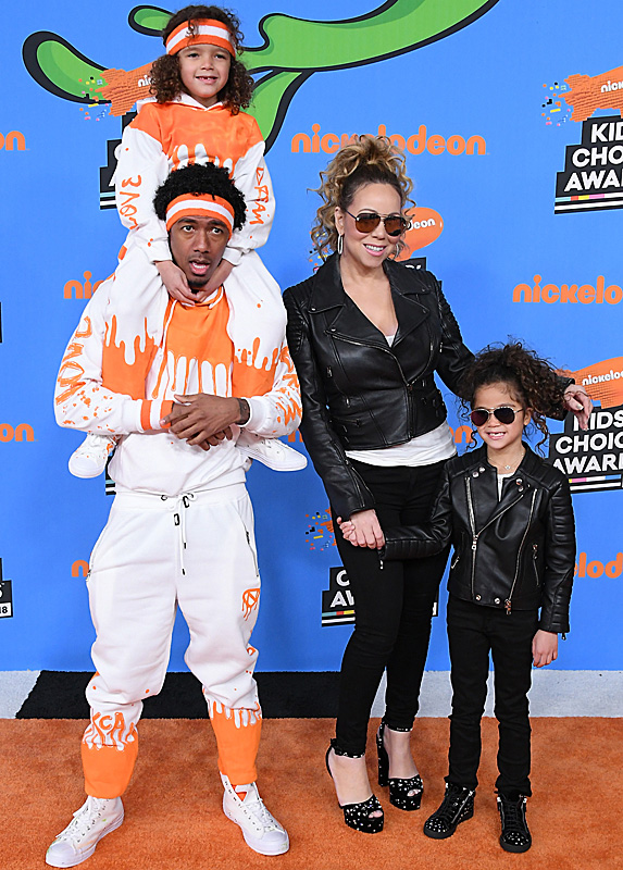 Nick Cannon, Mariah Carey and children Moroccan (on Nick's shoulders) and Monroe at the Kids' Choice Awards