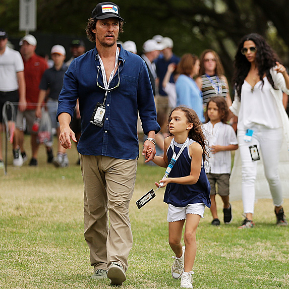 Matthew McConaughey walking with daughter Vida at golf tournament