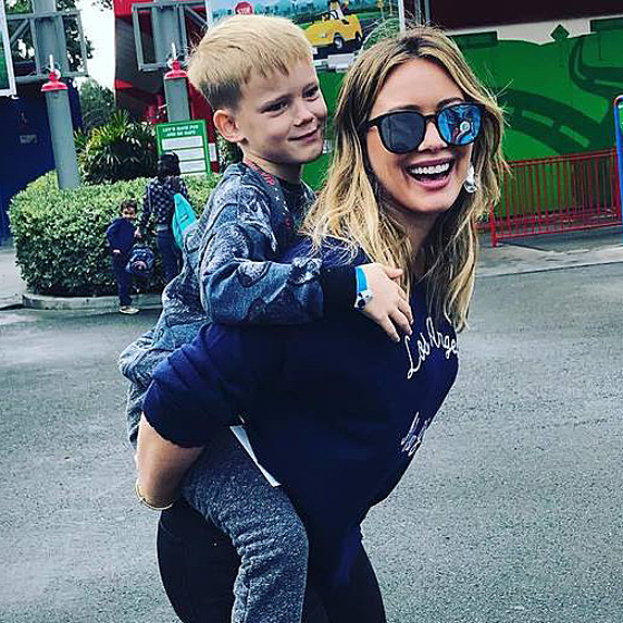 Hilary Duff piggybacking son Luca