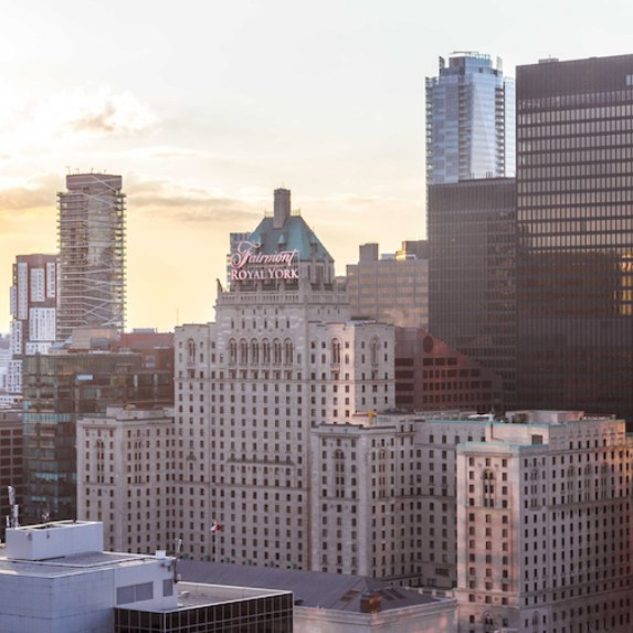 An exterior sunset view of Toronto's Fairmont Royal York Hotel