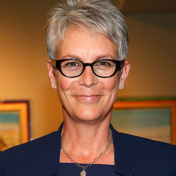 Jamie Lee Curtis in glasses smiling at the camera
