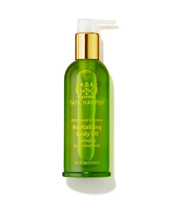 Green dispenser bottle of body oil