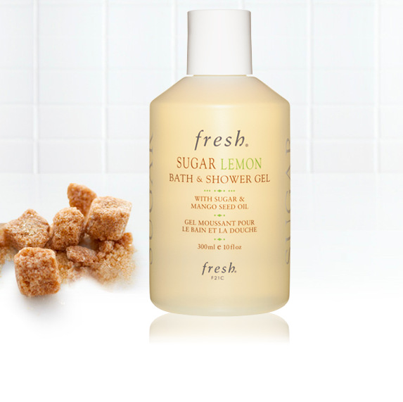 Brown sugar cubes and a bottle of shower gel product