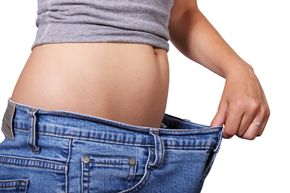 diet image of woman in too-large jeans