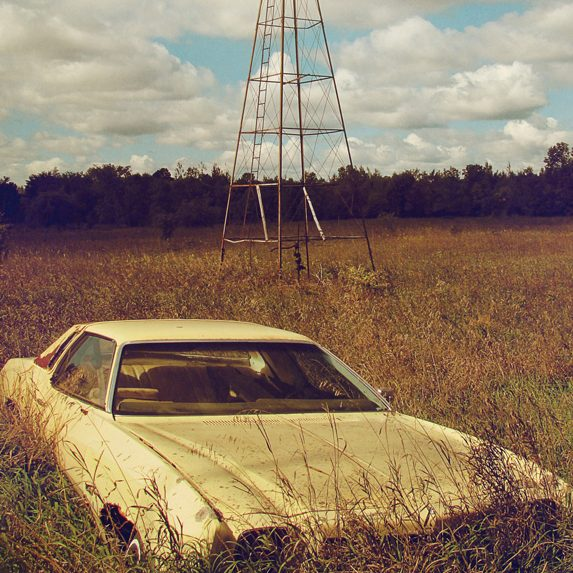 Car and windmill near Ottawa, Ontario