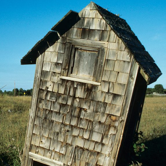 Leaning outhouse on Manitoulin Island, Ontario