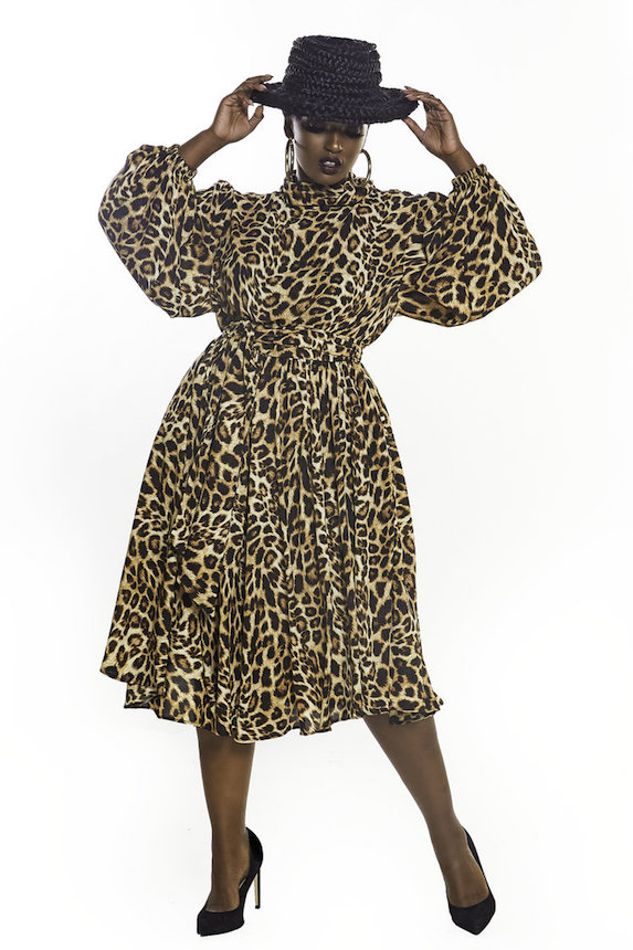 Model wears leopard print dress