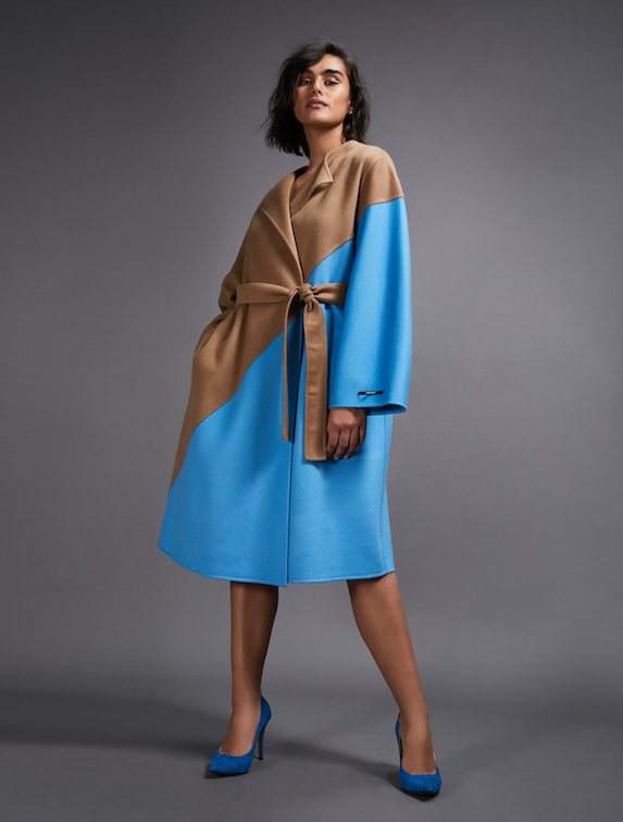 Model wears a blue and camel wool coat by Marina Rinaldi