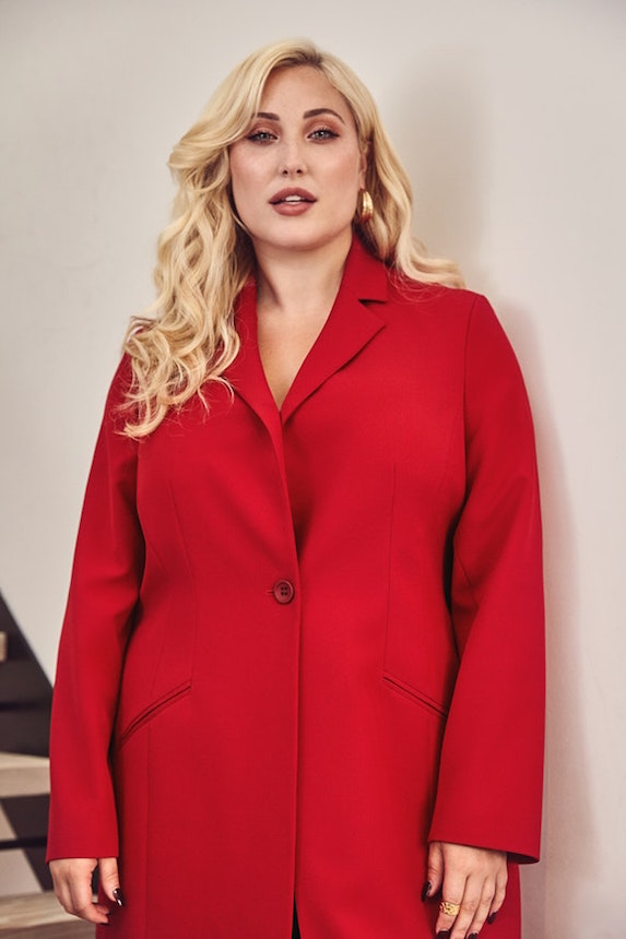 Model wears a red coat from Navabi brand of clothing