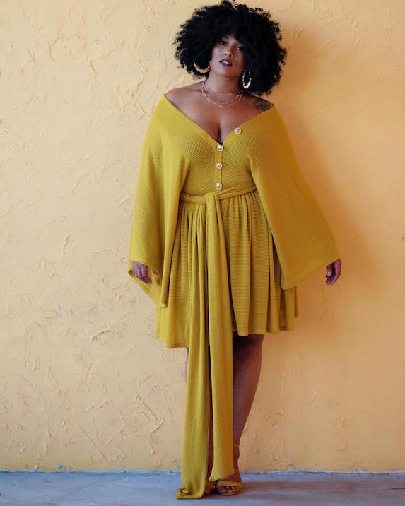 Model wears a bright yellow dress from plus-size brand Zelie for She