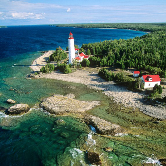 Arial shot of Bruce Peninsula coast with a lighthouse