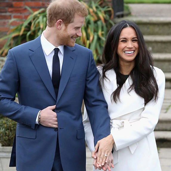 Prince Harry and Meghan Markle walking and laughing