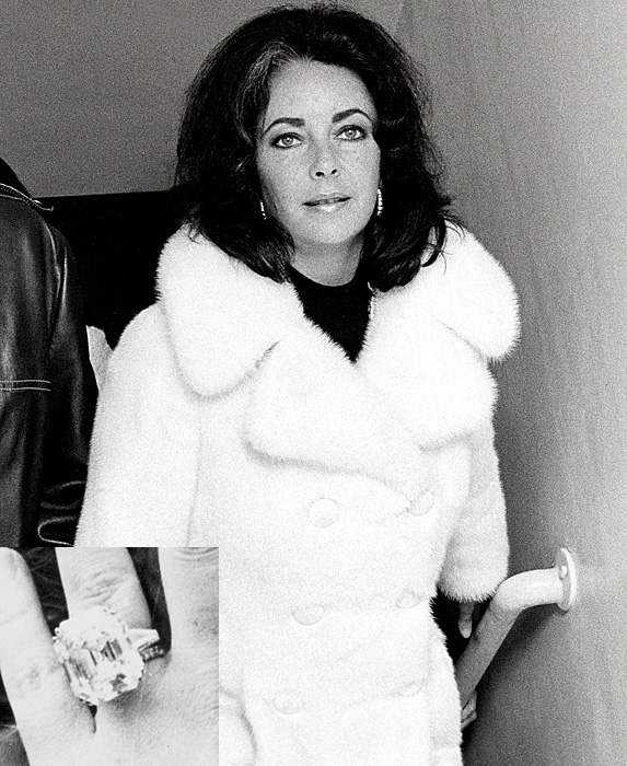 Black and white pic of Elizabeth Taylor in white fur coat