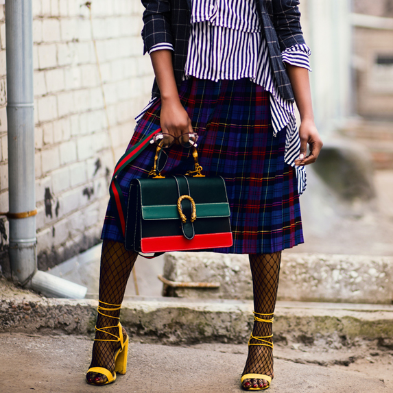 Woman wearing yellow heels with multiple straps and fashionable outfit