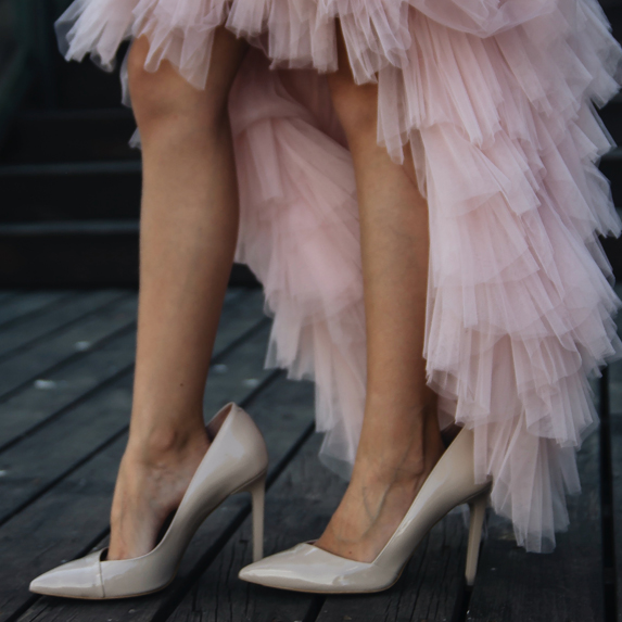 Woman wearing heels and frilly pink dress