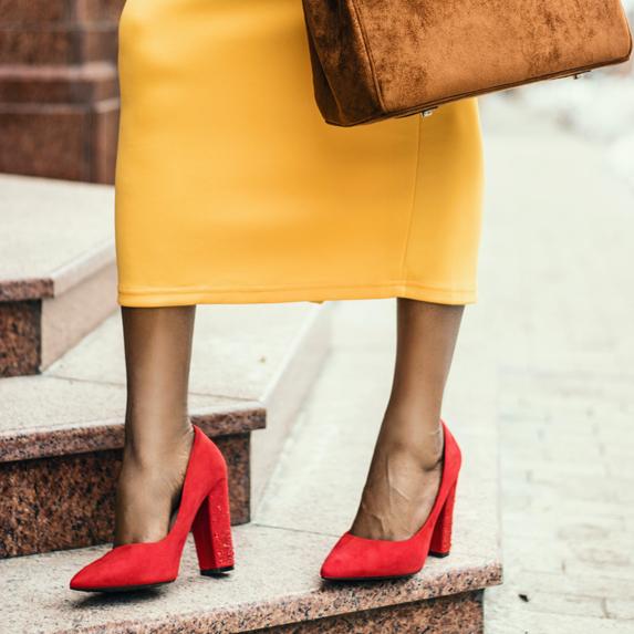 Woman wearing chunky red high heels