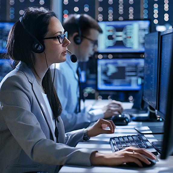 Female dispatcher at computer