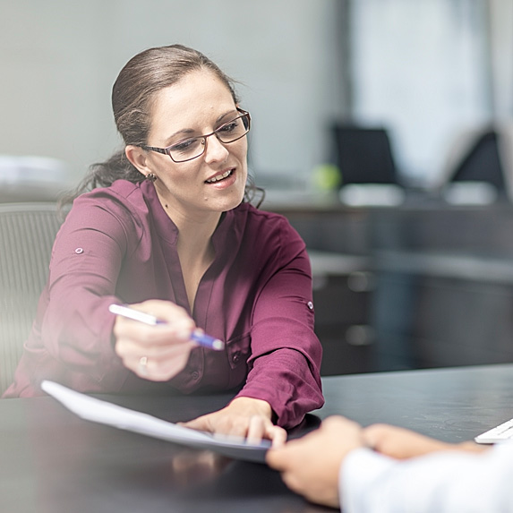 Woman showing report to employee