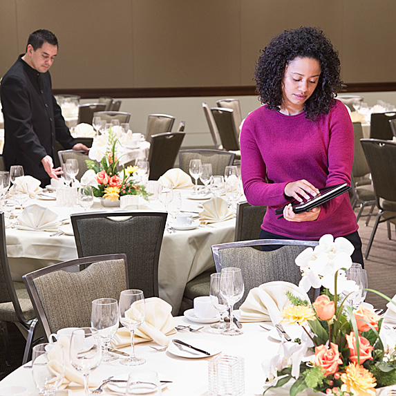 Woman making finishing touches for event in meeting room