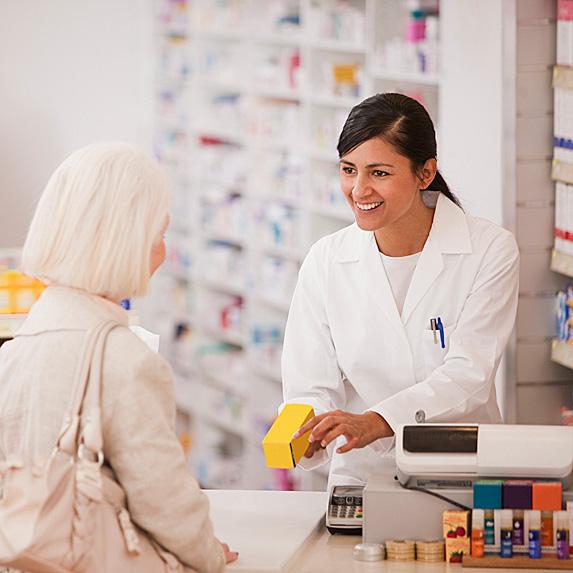 Pharmacist speaking to older woman