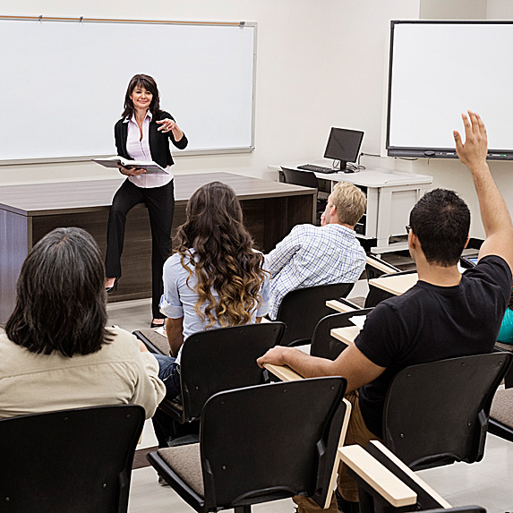Woman teaching classroom of students