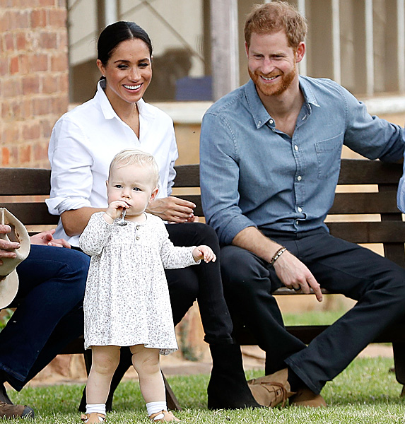 Meghan and Harry smiling at baby girl