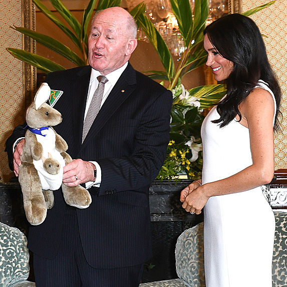 with Governor-General Sir Peter Cosgrove holding stuffed kangaroo with Meghan next to him