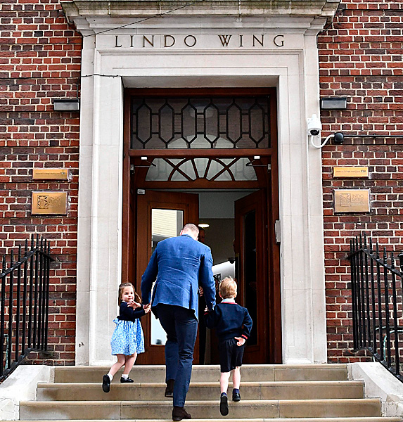 Prince William, Charlotte and George walking up steps of the Lindo Wing