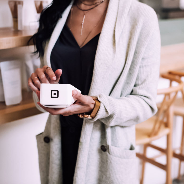 women paying for coffee with credit card