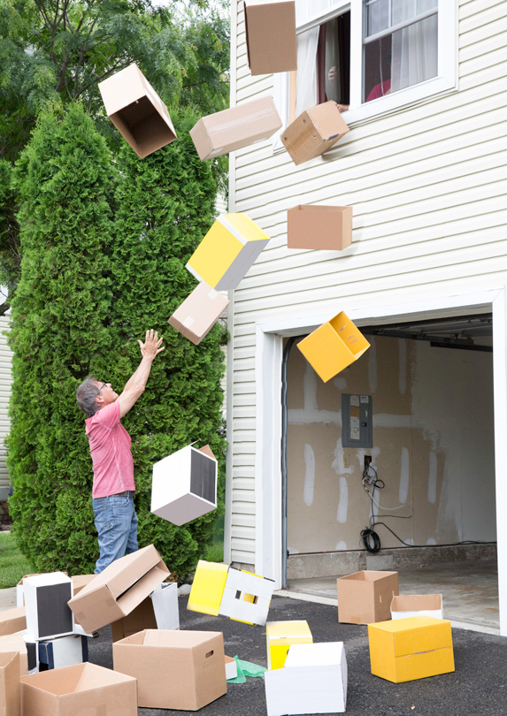 Boxes being thrown out a window