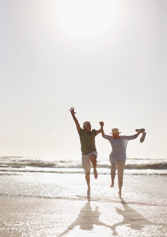 Couple running on a beach