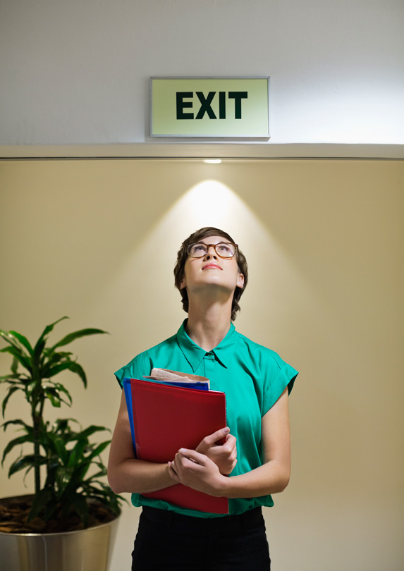 Woman looking at an exit sign