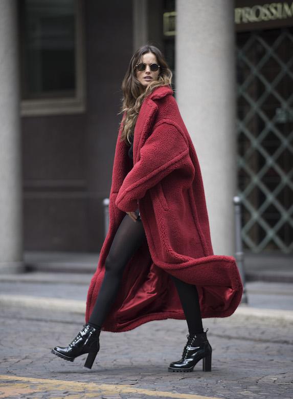 Model Izabel Goulart wears a red shearling winter coat