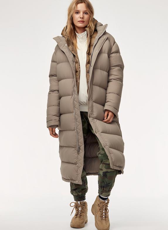 Model wears a long oversized puffer coat