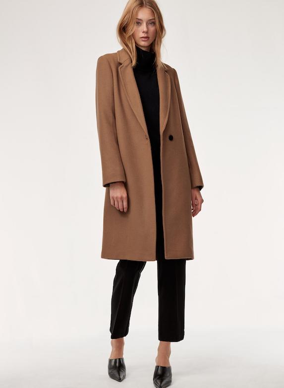 Model wears a classic wool coat